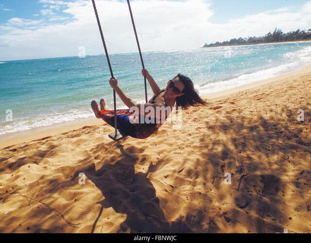 Woman On Beach Swing - Stock Image