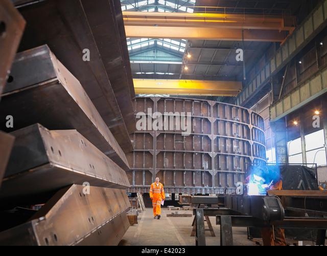 Engineer in marine fabrication factory - Stock Image