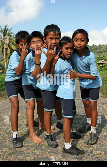 Cheeky Indonesian School Lads Doing 'Rock' Sign - Stock Image