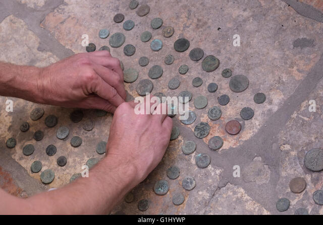 Stack of ancient Roman coins at Baidun antiquity shop located on Via Dolorosa Old city East Jerusalem, Israel - Stock Image