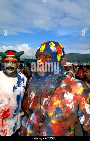 Trinidad Carnival JOuvert morning people wearing painted mud - Stock Image