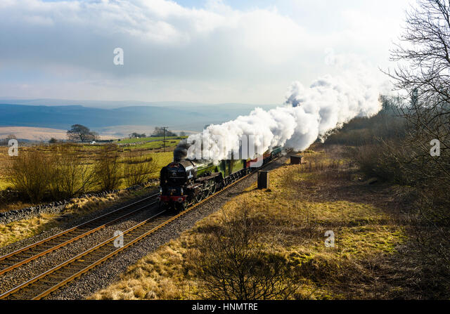 Ribblesdale, North Yorkshire, UK. 14th Feb, 2017. Steam locomotive Tornado hauls a train through Ribblesdale on - Stock Image