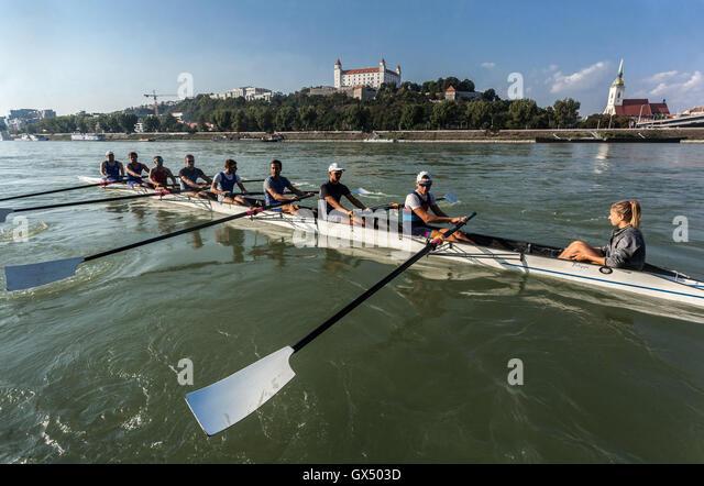 Bratislava Castle, racing boat eights on Danube, Slovakia, Europe - Stock Image