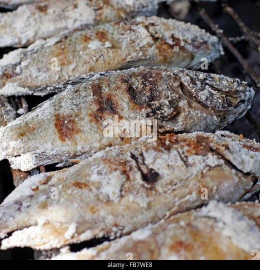 Burn fish stock photos burn fish stock images alamy for Bluesalt fish grill