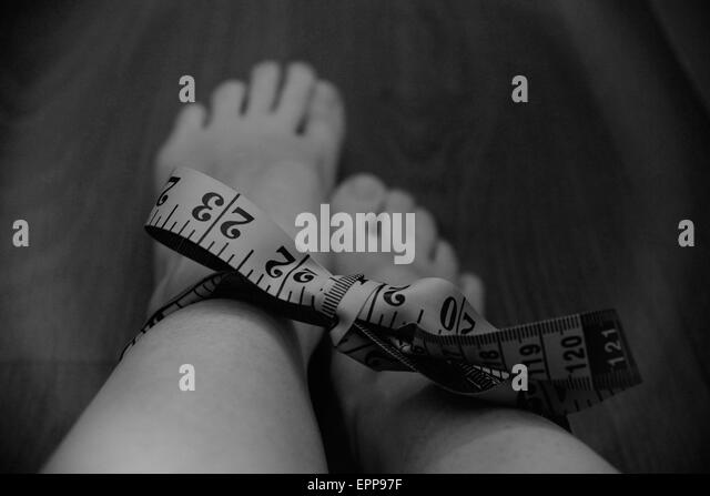 weight, eating disorder, anorexia, conceptual photography, bulima, illness, slim, fat, bullying, trapped, depression, - Stock Image