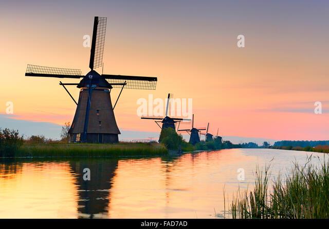 Kinderdijk windmills at sunrise - Holland Netherlands - Stock Image