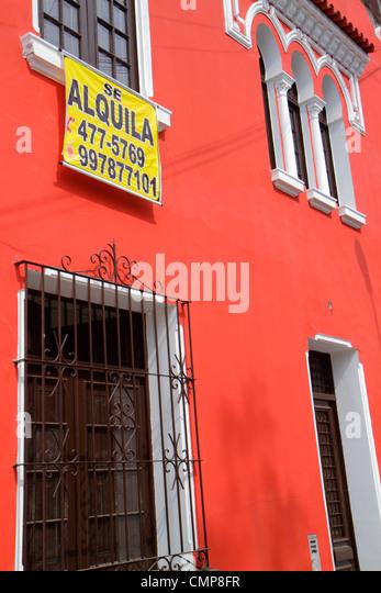 Lima Peru Barranco District Calle Colon residential neighborhood house facade exterior wrought iron window bars - Stock Image