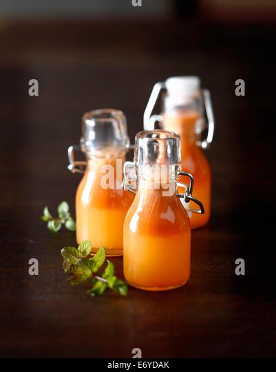 Apple,orange and carrot juice - Stock Image