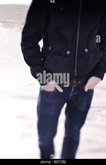 teenager with hands in pockets - Stock Image