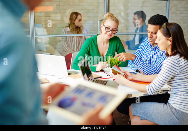 Team of designers choosing a color for new interior - Stock Image