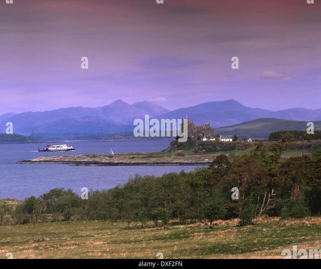 An Archive picture of the old M.V.Iona passing Duart castle in the 1980's. - Stock Image