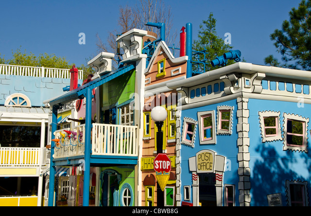 Curious George Goes To Town kids attraction kids with water guns at Universal Studios Orlando  Florida - Stock Image