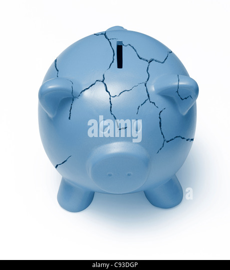 Cracked blue piggy bank on a white background signifying the poor state of the economy - Stock Image