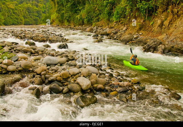 Kayaker paddling on the Lower Pacuare River. Costa Rica - Stock Image