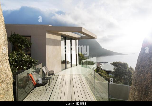 Wooden balcony of modern house - Stock-Bilder