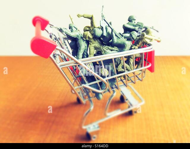A shopping cart full of plastic toy soldiers. - Stock Image