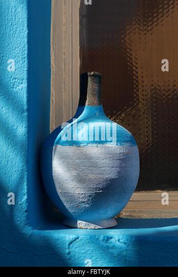 Still Life - Blue pottery on window sill. - Stock Image
