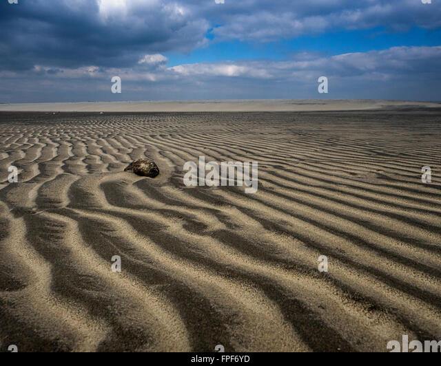 Close up of ripples in the sand and a pebble at East Head, West Wittering, West Sussex - Stock Image