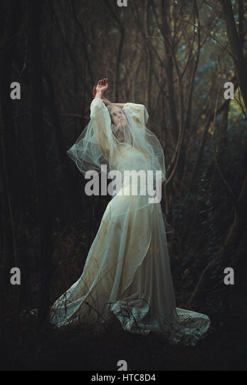 Sad bride with veil in the forest. Dark and surreal - Stock-Bilder
