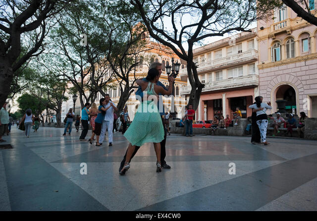 Horizontal view of Cubans dancing Tango in the street in Havana, Cuba. - Stock Image