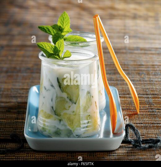 Tzatziki in yoghurt pots - Stock Image