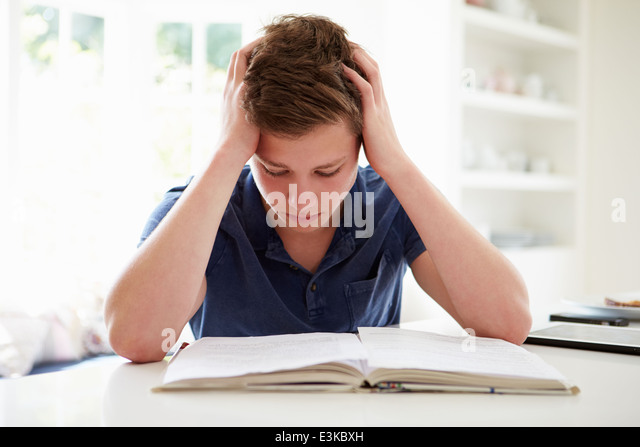 Depressed Boy Studying At Home - Stock Image