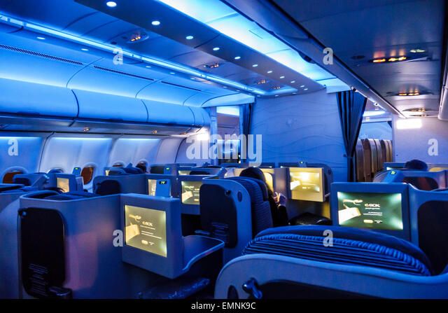 Virginia Dulles International Airport IAD terminal Etihad Airways Business Class onboard cabin low light blue mood - Stock Image