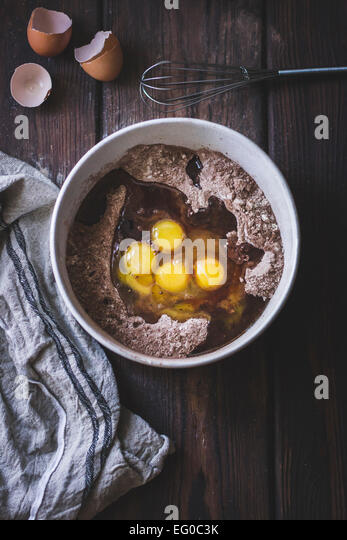 Eggs and cocoa mixture in a bowl - Stock Image