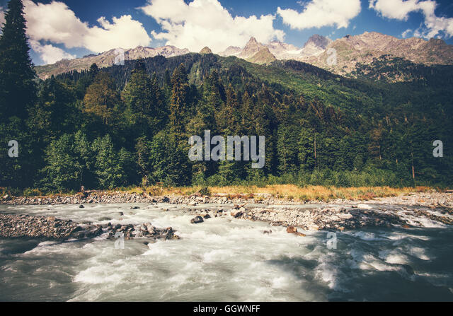 Mountains River and forest Landscape with blue sky clouds beautiful scenic view wild nature summer travel in Abkhazia - Stock Image