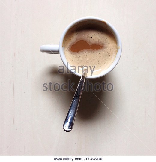 Close-Up Overhead View Of Tea Cup Against White Background - Stock-Bilder