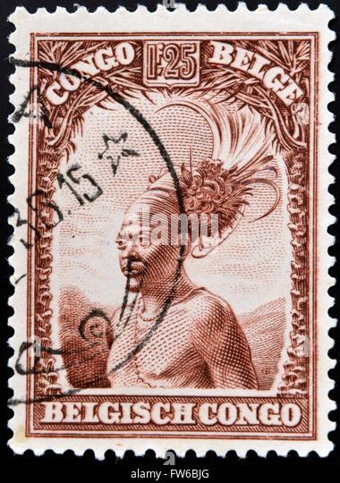 BELGIAN CONGO - CIRCA 1942: A stamp printed in Belgian Congo shows Head of a native men, circa 1942 - Stock-Bilder