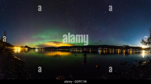 Aurora borealis over Okanagan Lake, Kickininee Provincial Park, Penticton, British Columbia, Canada - Stock Image