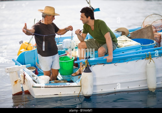 Fishermen on boat - Stock Image