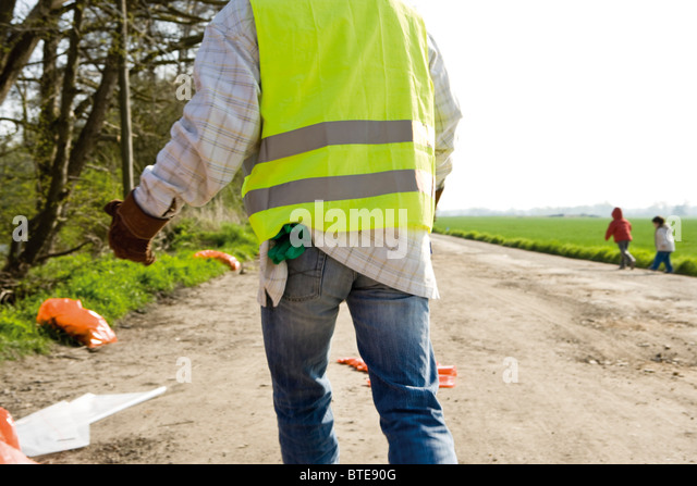 Picking up roadside litter - Stock Image