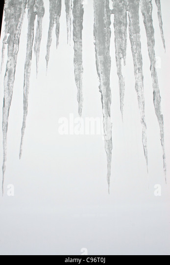 Icicles form at minus 12 degrees centigrade outside The Sphinx observatory at Jungfraujoch. - Stock Image