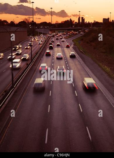 Sunset scenery of commute traffic at Toronto Gardiner Expressway, Ontario, Canada. - Stock Image