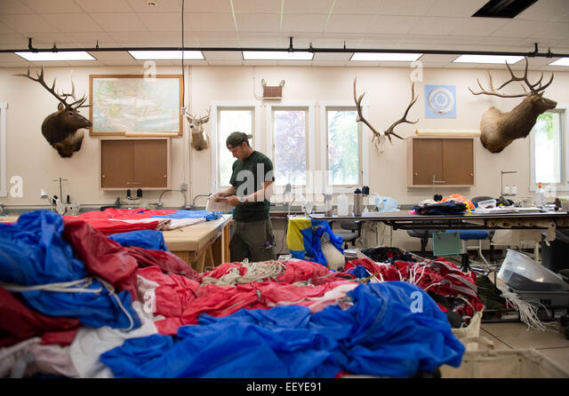 Smoke Jumpers sew their parachutes in the training center in MIssoula, Montana, May 23, 2014. Smoke jumping is a - Stock Image
