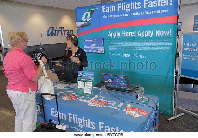 Maryland Baltimore BWI Baltimore Washington International Thurgood Marshall Airport AirTran passenger woman job - Stock Image