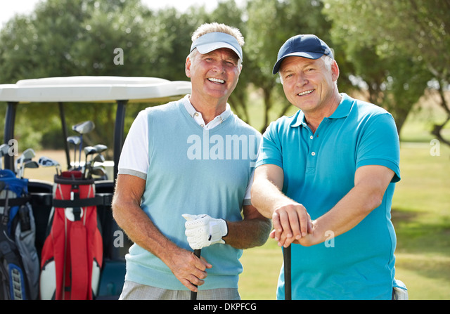 Senior men on golf course - Stock Image