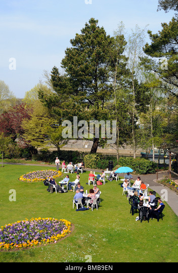 people relaxing in parade gardens, bath ,england, uk - Stock Image