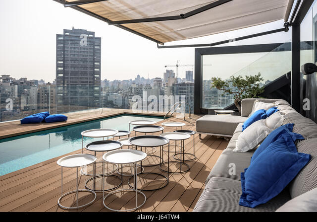 Roof top swimming pool with views of Beirut - Stock Image