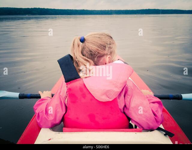 Little girl in kayak on a lake - Stock-Bilder