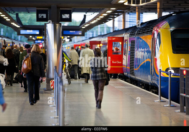 Commuters boarding an East Midlands Trains service from St. Pancras International station - Stock Image