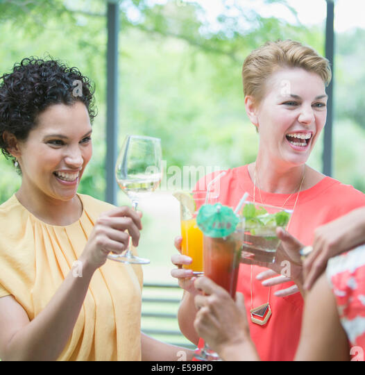 Women toasting each other at party - Stock Image