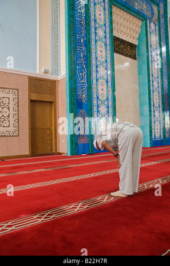 Muslim man at prayer inside Mosque 'Nur-Astana' in Astana capital of Kazakhstan - Stock Image