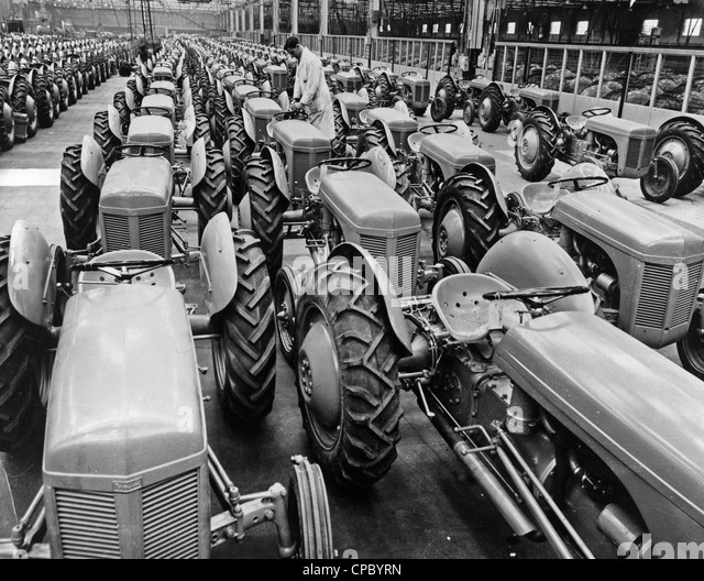 Pic shows completed Ferguson tractors filling the bays at the Banner Lane Factory of Standard Motors. 1951 - Stock Image