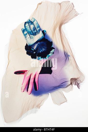 Polaroid emulsion transfer of gloves. - Stock Image