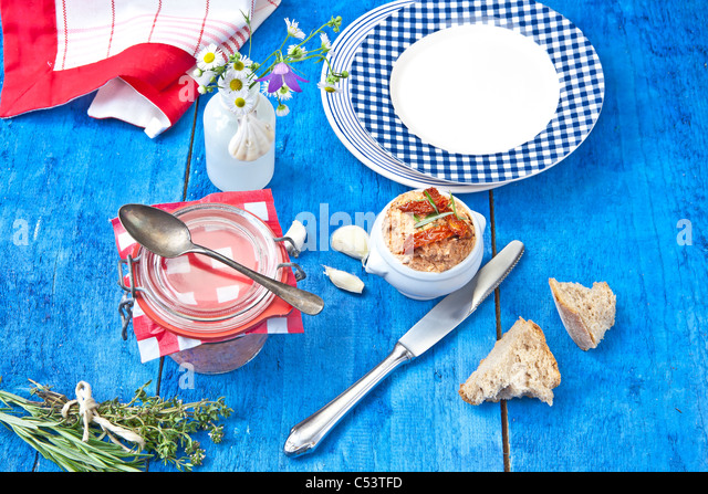 Mediterranean cheese spread made from cream cheese, feta cheese, artichokes and sun-dried tomatoes and herbs - Stock Image
