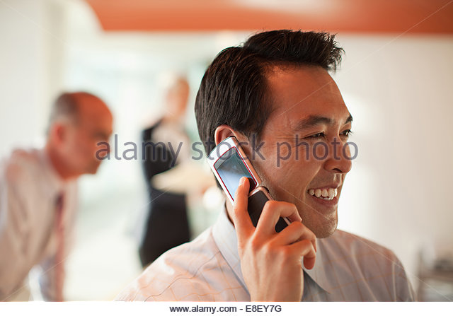 Businessman talking on cell phone - Stock-Bilder