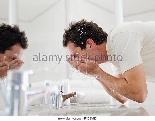 Man washing face - Stock Image